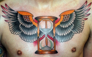 winged hourglass tattoo chest piece
