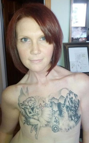 Kelly Davidson, 34, shows off her tattoo that covers scars after battling three separate bouts of cancer. (Facebook)